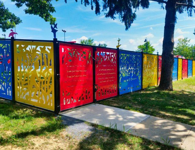 custom powder coated fence surrounding playground