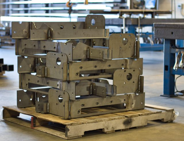 gear box mounting brackets sitting on skid in blue lake industries warehouse