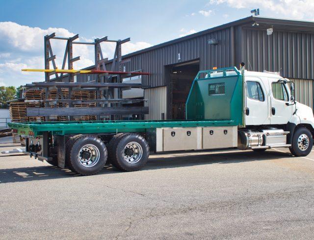 custom truck bed sitting outside blue lake building